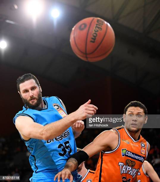 Michael Carrera of the Taipans and Alex Pledger of the Breakers contest the ball during the round five NBL match between the Cairns Taipans and the...