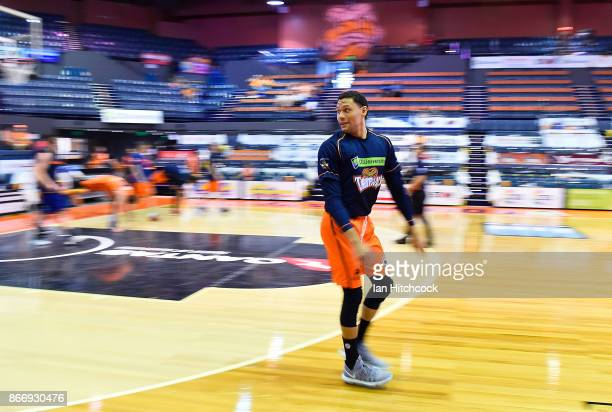 Michael Carrera of the Taipans warms up before the start of the round four NBL match between the Cairns Taipans and the Adelaide 36ers at Cairns...