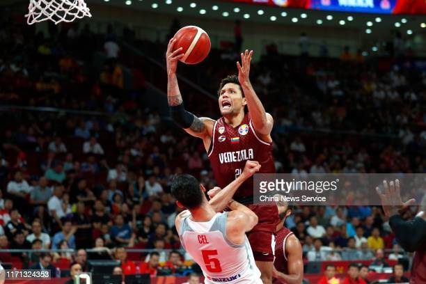 Michael Carrera of Venezuela and Aaron Cel of Poland in action during FIBA World Cup 2019 group match between Poland and Venezuela at Cadillac Arena...