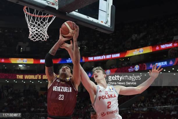 Michael Carrera of Venezuela and Aleksander Roman Balcerowski of Poland in action during FIBA World Cup 2019 group match between Poland and Venezuela...