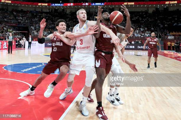 Michael Carrera of Venezuela National Team and Michal Sokolowski of Poland National Team in action during FIBA World Cup 2019 group match between...