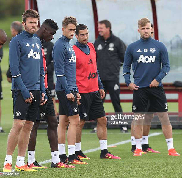 Michael Carrick Adnan Januzaj Henrikh Mkhitaryan and Luke Shaw of Manchester United in action during a first team training session at Aon Training...