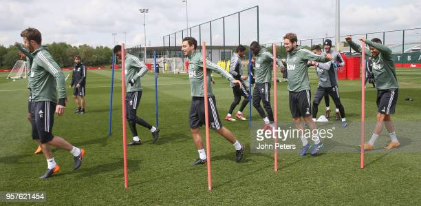 Michael Carrick and Matteo Darmian and Daley Blind of Manchester United in action during a first team training session at Aon Training Complex on May...