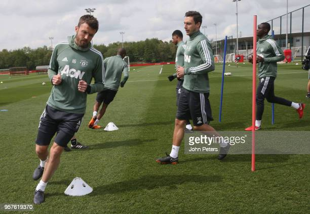 Michael Carrick and Matteo Darmian of Manchester United in action during a first team training session at Aon Training Complex on May 12 2018 in...