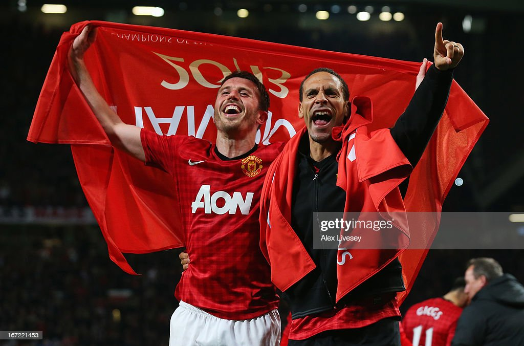 Michael Carrick (L) and Rio Ferdinand of Manchester United celebrate winning the Premier League title after the Barclays Premier League match between Manchester United and Aston Villa at Old Trafford on April 22, 2013 in Manchester, England.