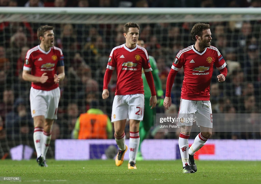 Michael Carrick, Ander Herrera and Juan Mata of Manchester United react to Pione Sisto of FC Midtjylland scoring their first goal during the UEFA Europa League match between Manchester United and FC Midtjylland at Old Trafford on February 25, 2016 in Manchester, United Kingdom.