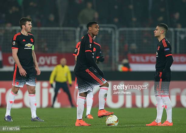 Michael Carrick Anthony Martial and Andreas Pereira of Manchester United react to Paul Onuachu of FC Midtjylland scoring their second goal during the...