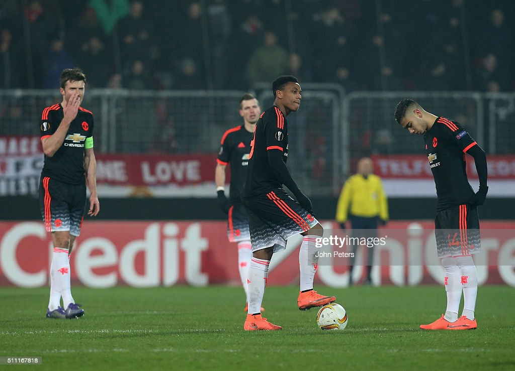 Michael Carrick, Anthony Martial and Andreas Pereira of Manchester United react to Paul Onuachu of FC Midtjylland scoring their second goal during the UEFA Europe League match between FC Midtjylland and Manchester United on February 18, 2016 at MCH Arena in Herning, Denmark.