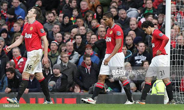 Michael Carrick Antonio Valencia and Rafael Da Silva of Manchester United show their disappointment during the Barclays Premier League match between...