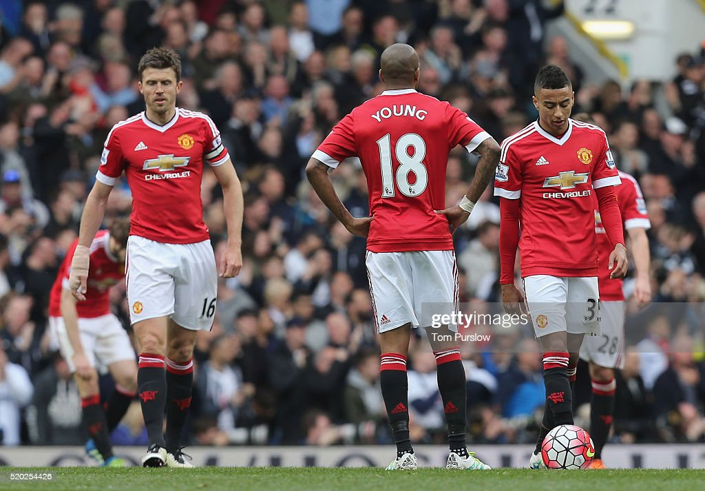 Michael Carrick, Ashley Young and Jesse Lingard of Manchester United react to Erik Lamela of Tottenham Hotspur scoring their third goal during the Barclays Premier League match between Tottenham Hotspur and Manchester United at White Hart Lane on April 10 2016 in London, England