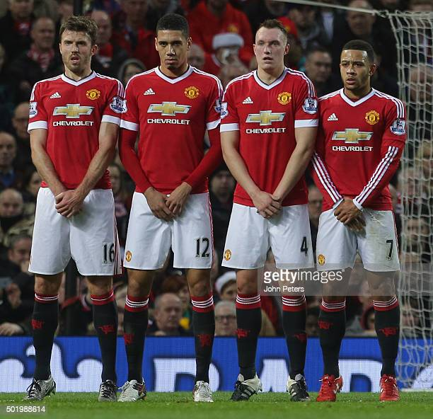 Michael Carrick Chris Smalling Phil Jones and Memphis Depay of Manchester United defend a freekick during the Barclays Premier League match between...