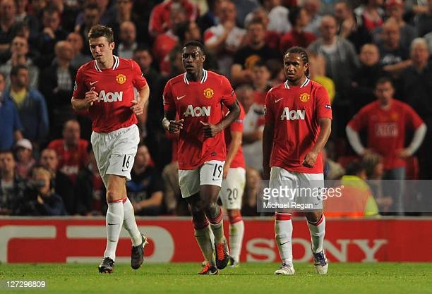 Michael Carrick Danny Welbeck and Anderson of Manchester United look dejected as as FabianFrei scores their firstgoal during the UEFA Champions...