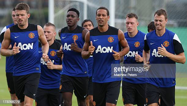 Michael Carrick, Danny Welbeck, Rio Ferdinand, Phil Jones and Jonny Evans of Manchester United jog during a first team training session at Royal...