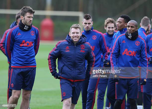 Michael Carrick Fitness Coach Gary Walker and Ashley Young of Manchester United in action during a first team training session at Aon Training...