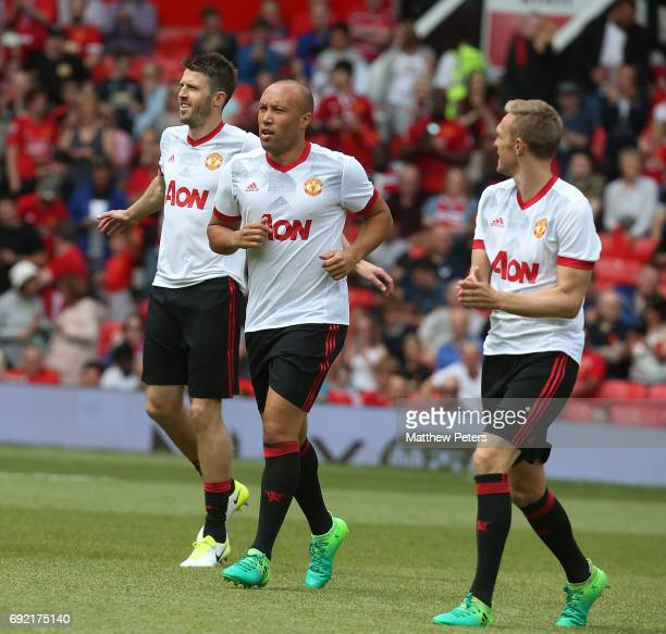 Michael Carrick Mikael Silvestre and Darren Fletcher of Manchester United '08 XI warm up ahead of the Michael Carrick Testimonial match between...