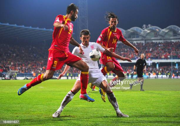 Michael Carrick of England battles with Mirko Vucinic and Dejan Damjanovic of Montenegro during the FIFA 2014 World Cup Qualifier Group H match...