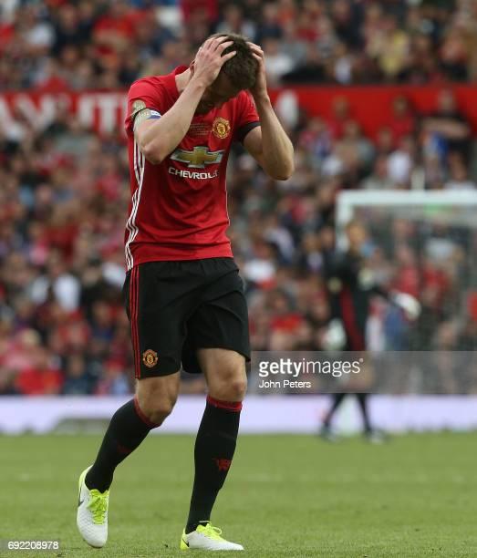 Michael Carrick of Manchester United '08 XI reacts to Gary Neville hitting a wayward shot during the Michael Carrick Testimonial match between...