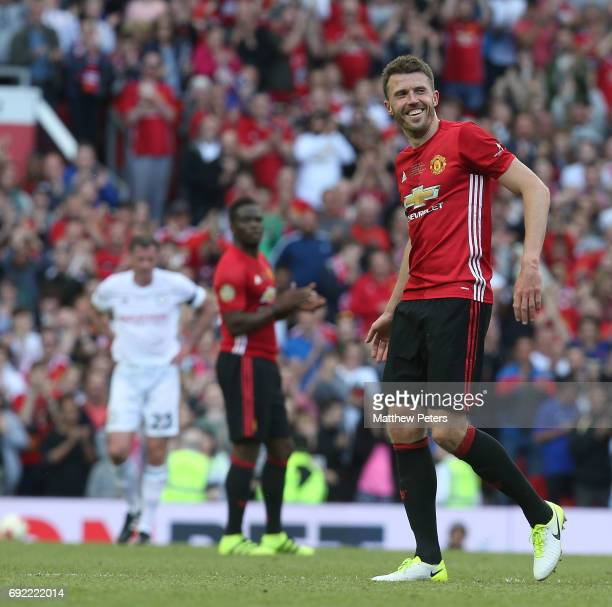 Michael Carrick of Manchester United '08 XI walks off after being substituted during the Michael Carrick Testimonial match between Manchester United...