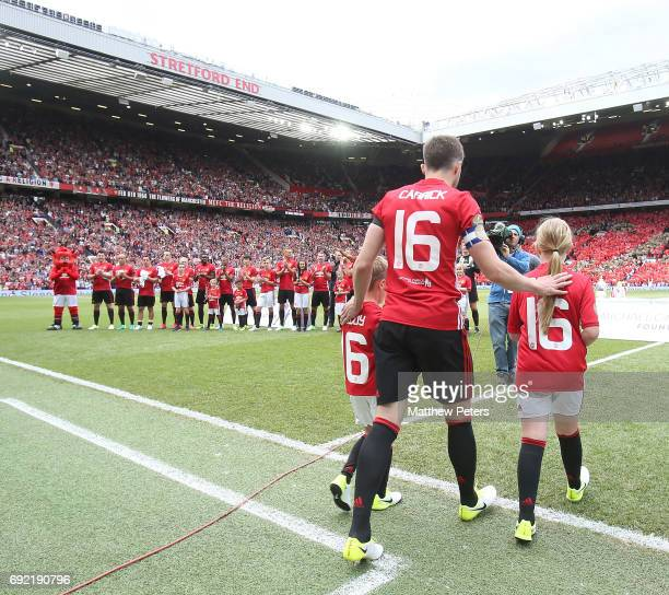 Michael Carrick of Manchester United '08 XI walks out ahead of the Michael Carrick Testimonial match between Manchester United '08 XI and Michael...