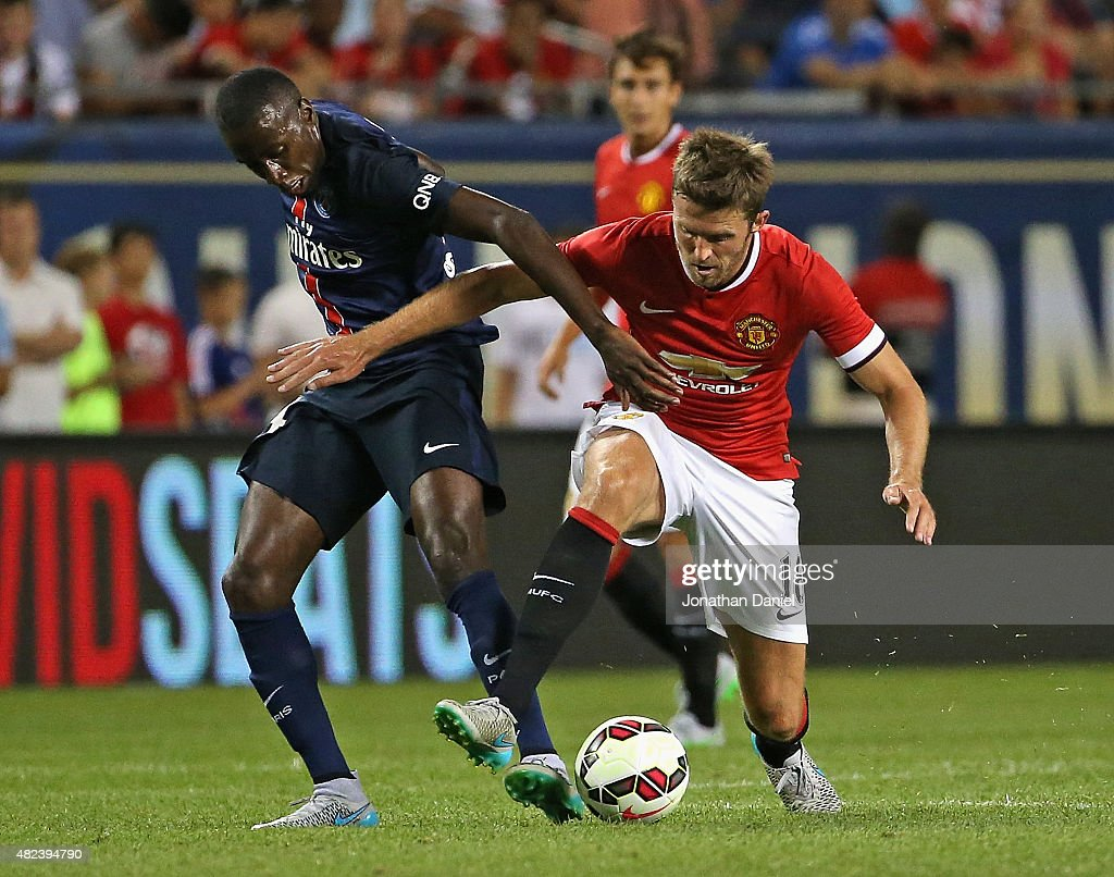 Michael Carrick #16 of Manchester United and Blaise Matuidi #14 of Paris Saint-Germain battle for the ball during a match in the 2015 International Champions Cup at Soldier Field on July 29, 2015 in Chicago, Illinois. Paris Saint-Germain defeated Manchester United 2-0.
