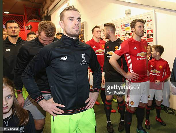 Michael Carrick of Manchester United and Jordan Henderson of Liverpool line up in the tunnel ahead of the Premier League match between Manchester...
