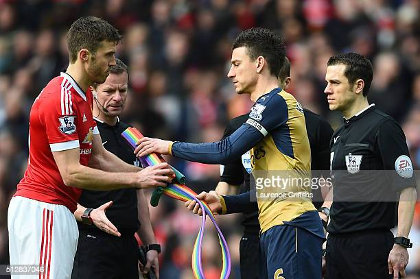 Michael Carrick of Manchester United and Laurent Koscielny of Arsenal exchange rainbow laces during the Barclays Premier League match between...