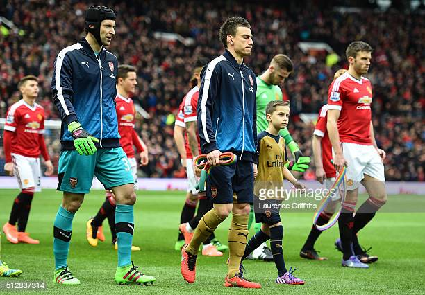 Michael Carrick of Manchester United and Laurent Koscielny of Arsenal walk out carrying rainbow laces during the Barclays Premier League match...