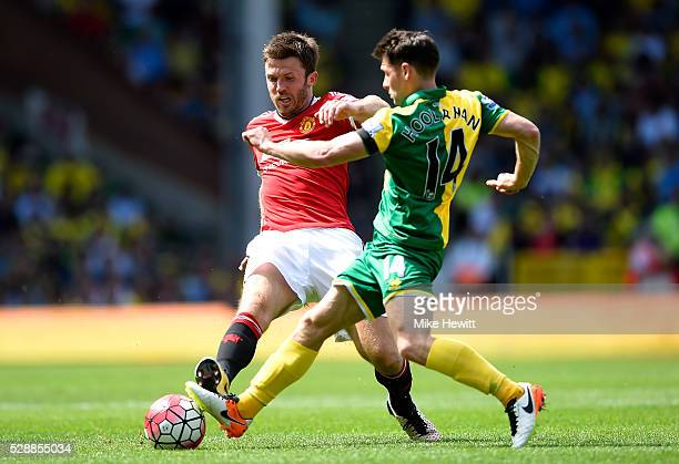 Michael Carrick of Manchester United and Wes Hoolahan of Norwich City compete for the ball during the Barclays Premier League match between Norwich...