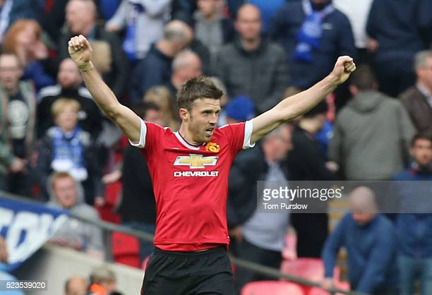 Michael Carrick of Manchester United celebrates at the final whistle of the Emirates FA Cup Semi Final match between Manchester United and Everton at...
