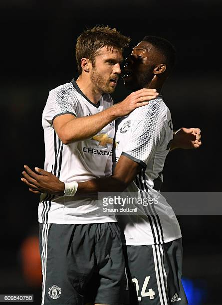 Michael Carrick of Manchester United celebrates scoring his sides first goal with Timothy FosuMensah of Manchester United during the EFL Cup Third...