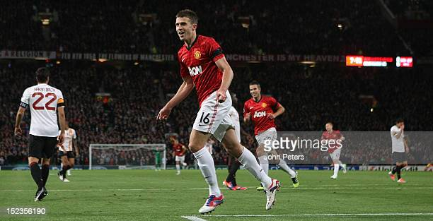 Michael Carrick of Manchester United celebrates scoring their first goal during the UEFA Champions League Group H match between Manchester United and...
