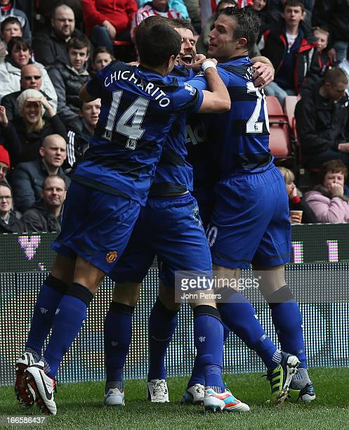 Michael Carrick of Manchester United celebrates scoring their first goal during the Barclays Premier League match between Stoke City and Manchester...