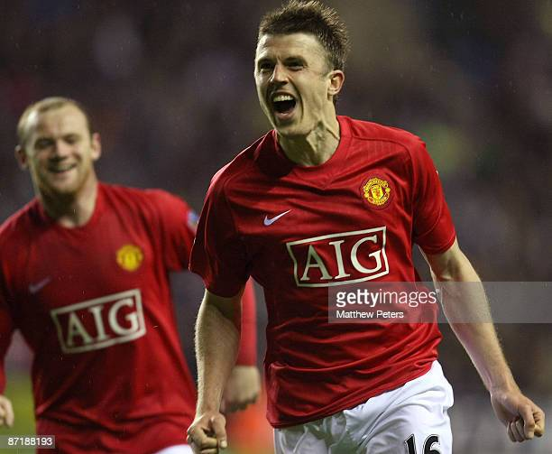 Michael Carrick of Manchester United celebrates scoring their second goal during the Barclays Premier League match between Wigan Athletic and...