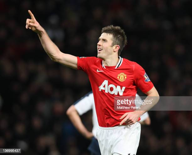 Michael Carrick of Manchester United celebrates scoring their third during the Barclays Premier League match between Manchester United and Bolton...