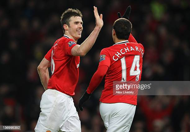 Michael Carrick of Manchester United celebrates with Javier Hernandez after scoring the third goal during the Barclays Premier League match between...