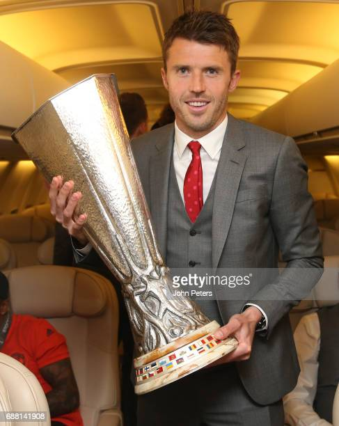 Michael Carrick of Manchester United celebrates with the Europa League trophy on the plane home after the UEFA Europa League Final match between...