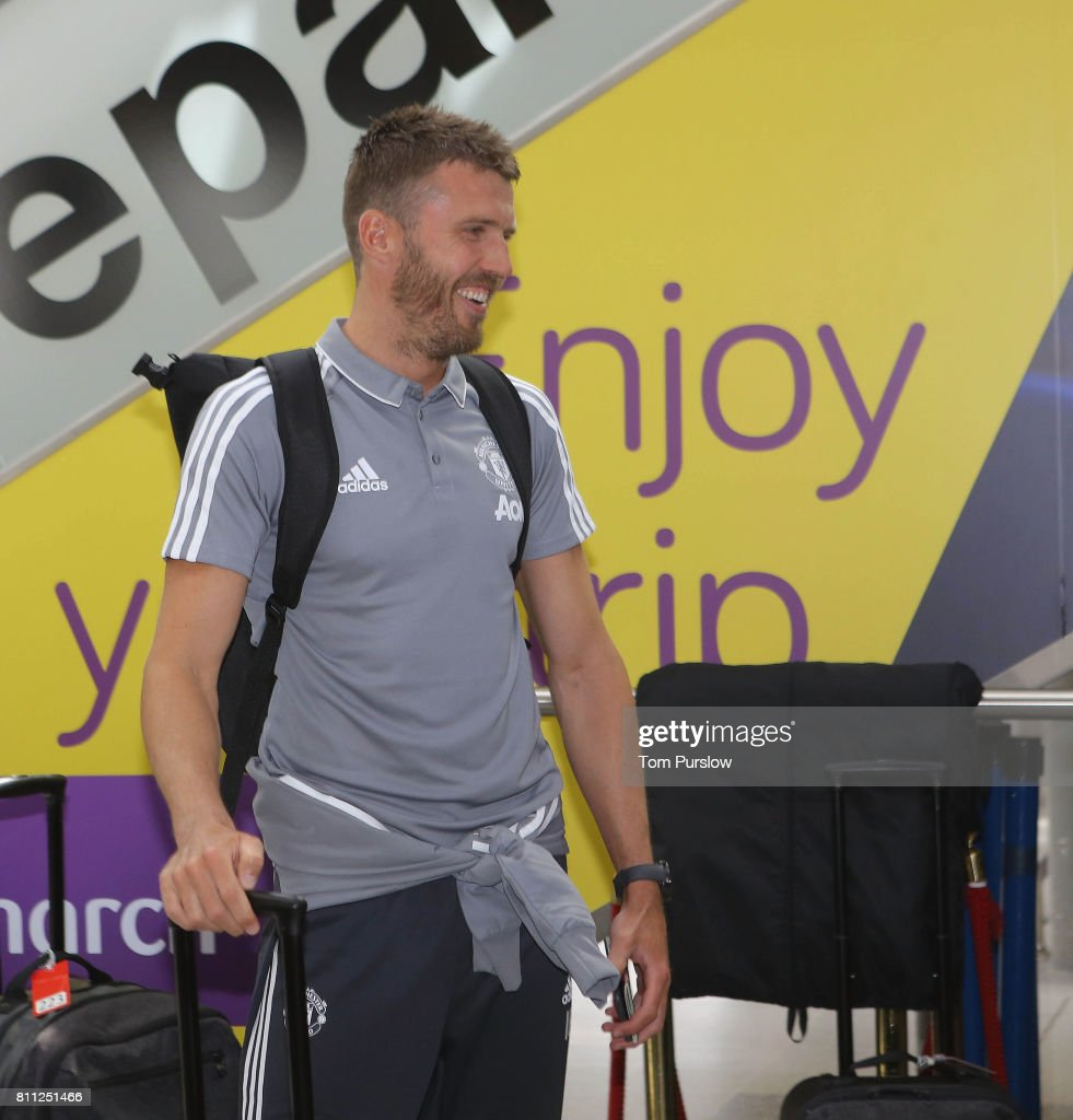 Michael Carrick of Manchester United checks in at Manchester Airport ahead of the club's pre-season tour of the USA at Manchester Airport on July 9, 2017 in Manchester, England.