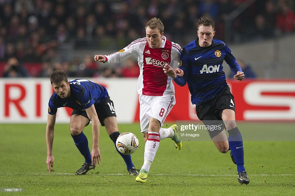 Michael Carrick of Manchester United, Christian Eriksen of Ajax,Phil Jones of Manchester United during the UEFA Europa League match between AFC Ajax and Manchester United FC at the Amsterdam Arena on February 16, 2012 in Amsterdam, Netherlands.