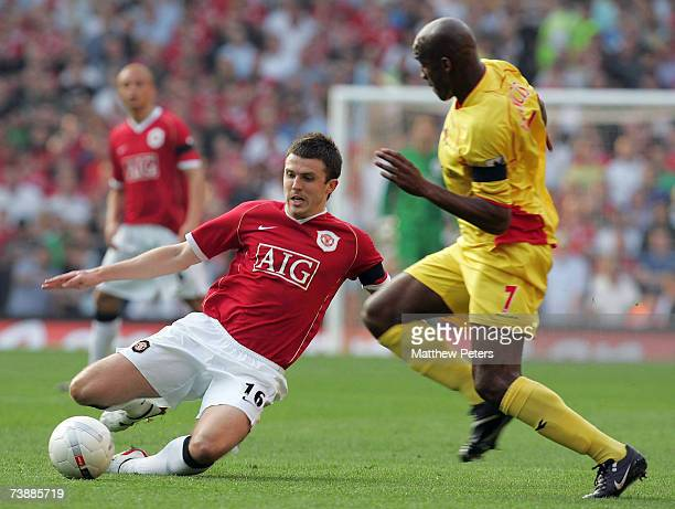 Michael Carrick of Manchester United clashes with Damien Francis of Watford during the FA Cup sponsored by E.ON Semi-final match between Watford and...