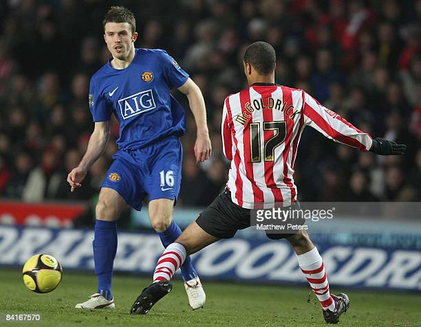 Michael Carrick of Manchester United clashes with David McGoldrick of Southampton during the FA Cup sponsored by eon Third Round match between...