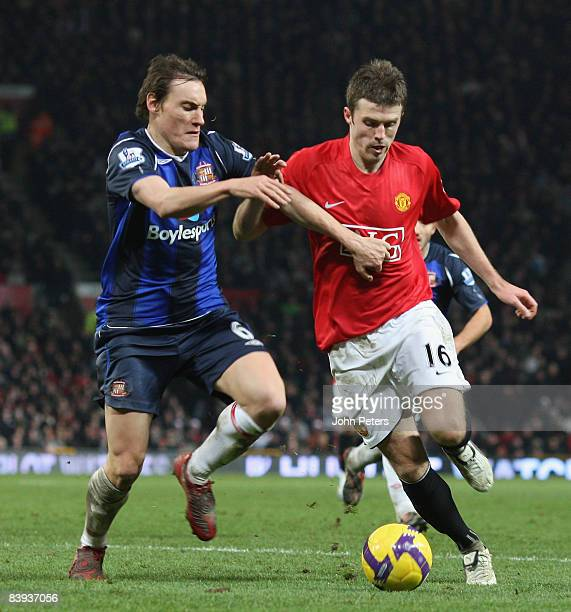 Michael Carrick of Manchester United clashes with Dean Whitehead of Sunderland during the Barclays Premier League match between Manchester United and...