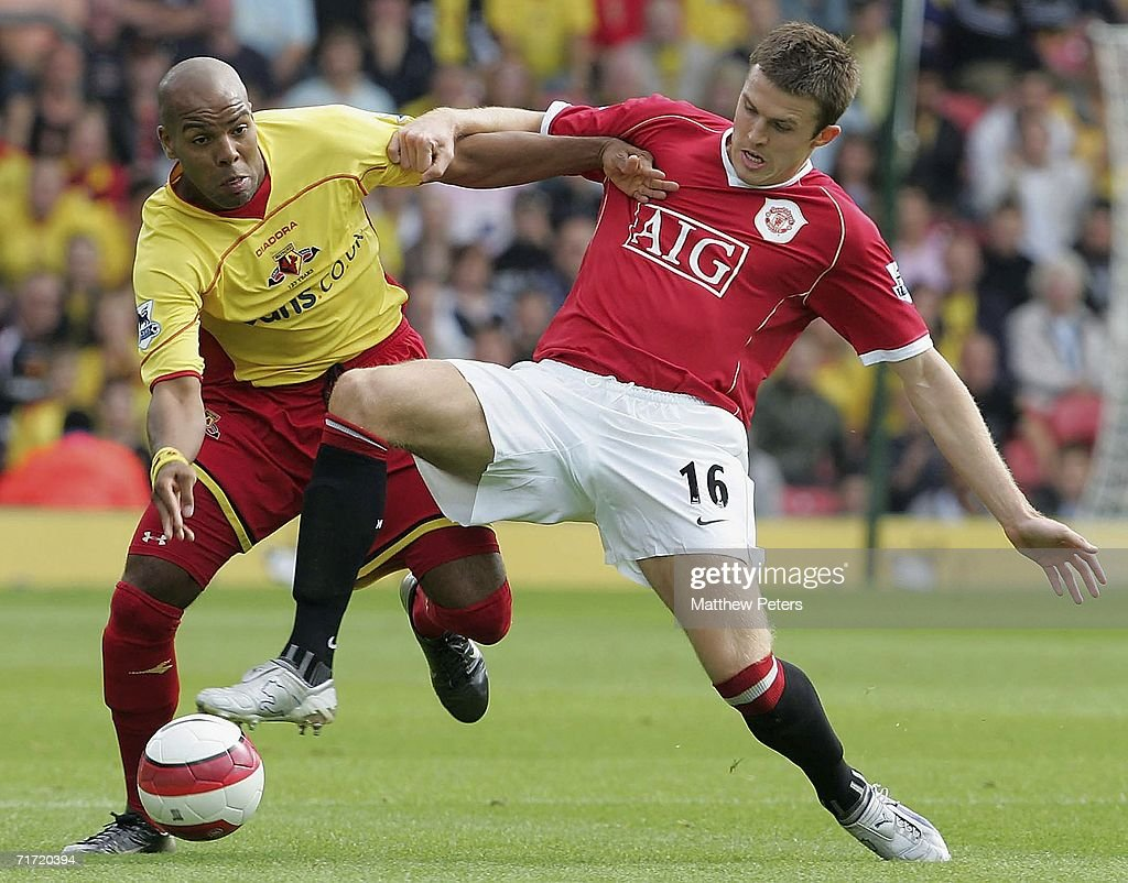 Michael Carrick of Manchester United clashes with Marlon King of Watford during the Barclays Premiership match between Watford and Manchester United at Vicarage Road on August 26 2006 in London, England.