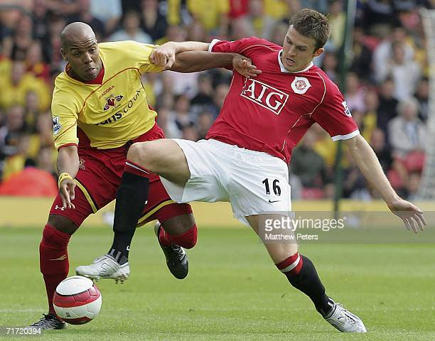 Michael Carrick of Manchester United clashes with Marlon King of Watford during the Barclays Premiership match between Watford and Manchester United...