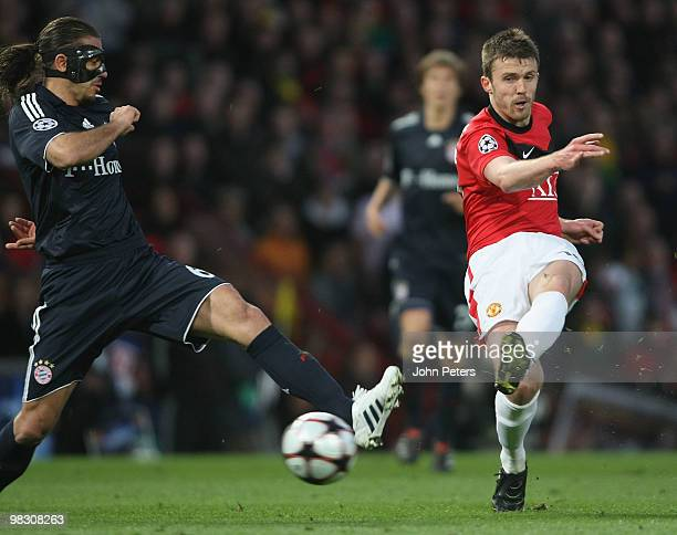 Michael Carrick of Manchester United clashes with Martin Demichelis of Bayern Munich during the UEFA Champions League QuarterFinal Second Leg match...