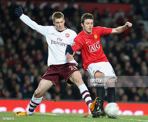 Michael Carrick of Manchester United clashes with Nicklas Bendtner of Arsenal during the FA Cup sponsored by e.on Fourth Round match between...