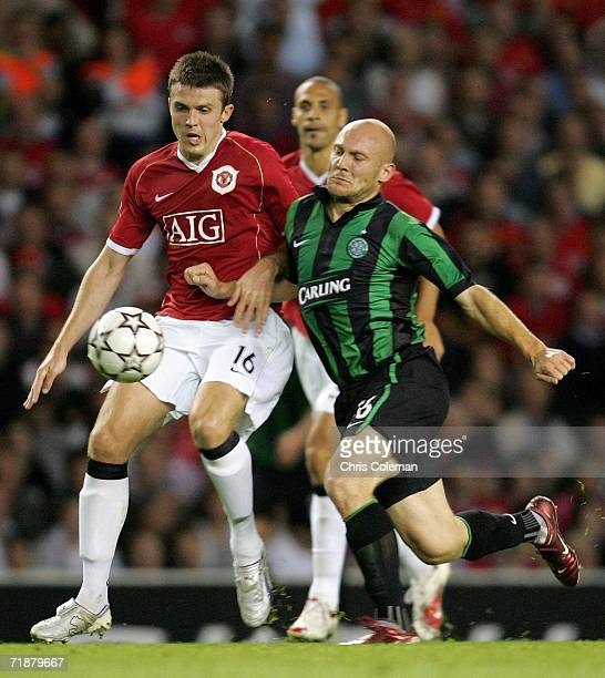 Michael Carrick of Manchester United clashes with Thomas Gravesen of Celtic during the UEFA Champions League match between Manchester United and...