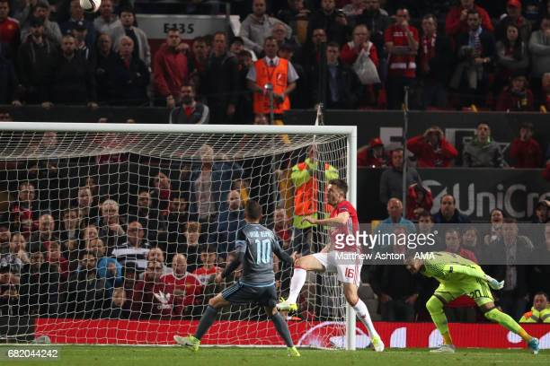 Michael Carrick of Manchester United clears off the line during the UEFA Europa League semi final second leg match between Manchester United and...