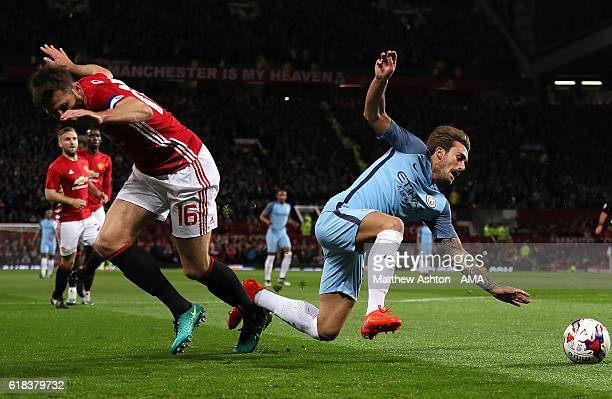 Michael Carrick of Manchester United competes with Aleix Garcia of Manchester City during the EFL Cup Fourth Round match between Manchester United...