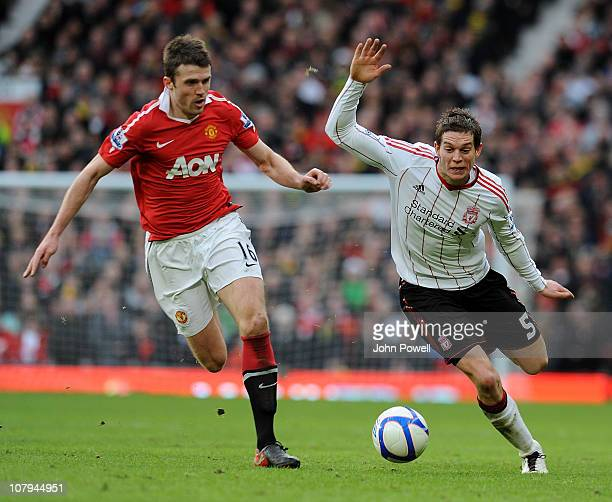 Michael Carrick of Manchester United competes with Daniel Agger of Liverpool during the FA Cup Sponsored by EON 3rd Round match between Manchester...