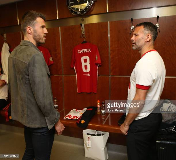Michael Carrick of Manchester United greets Ryan Giggs ahead of the Michael Carrick Testimonial match between Manchester United and Michael Carrick...
